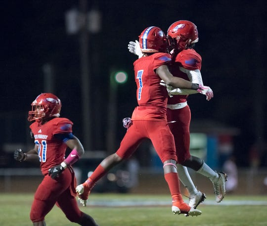 Tehrenzo Turner (7) celebrates with Dacarrion Mcwilliams (5) after intercepting a Jaguars pass during the West Florida vs Pine Forest football game at Pine Forest High School in Pensacola on Friday, October 11, 2019.