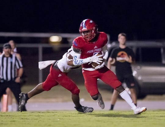 Dacarrion Mcwilliams (5) intercepts a Jaguars pass during the West Florida vs Pine Forest football game at Pine Forest High School in Pensacola on Friday, October 11, 2019.