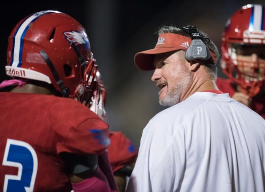 Head coach Jason McDonald talks with his players during a time out in the West Florida vs Pine Forest football game at Pine Forest High School in Pensacola on Friday, October 11, 2019.