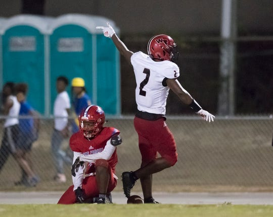 Simeon Price (2) signals first down after reeling in a long pass down field during the West Florida vs Pine Forest football game at Pine Forest High School in Pensacola on Friday, October 11, 2019.