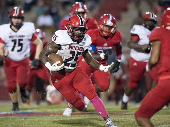 Jaheim Simmons (25) carries the ball during the West Florida vs Pine Forest football game at Pine Forest High School in Pensacola on Friday, October 11, 2019.