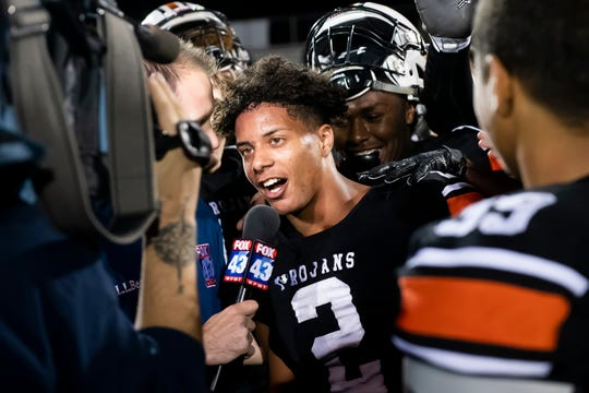 York Suburban's Savion Harrison is interviewed by Fox 43 after the Trojans defeated Gettysburg 30-19 in a YAIAA Division II football game in Spring Garden Township on Friday, October 11, 2019.