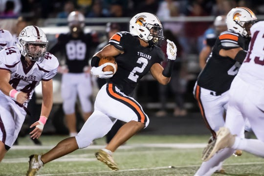 York Suburban's Savion Harrison (2) takes off on a 58-yard touchdown-scoring run in the first quarter against Gettysburg in Spring Garden Township on Friday, October 11, 2019.