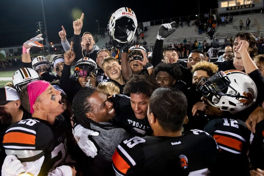 The York Suburban Trojans cheer on Savion Harrison (center) after defeating Gettysburg 30-19 on Friday, October 11, 2019. Harrison finished the game with 311 rushing yards and four touchdowns.