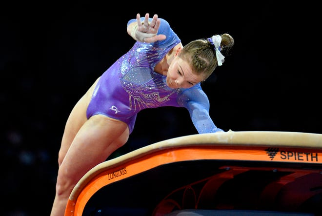 Jade Carey of Phoenix earned a silver medal in vaulting Saturday at the World Gymnastics Championships in Stuttgart, Germany.