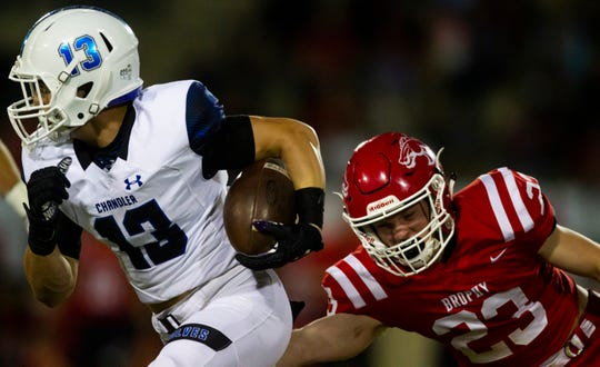 Brophy's Carter Niebling tries to bring down Chandler's Gunner Maldonado during a game Oct. 11.
