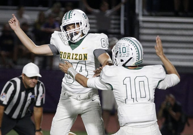 Horizon kicker Grady Gross (84) and Jake Martinelli (10) celebrate their overtime win over Notre Dame Prep's during their game in Scottsdale, Friday, Oct. 11, 2019.