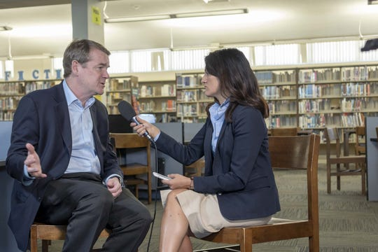 Arizona Republic reporter Yvonne Wingett Sanchez holds a one-on-one interview with Colorado Sen. Michael Bennet, a former educator who is running as a Democrat for president, after he hosted an education-themed roundtable at the library at Tempe High School on Oct. 11, 2019.