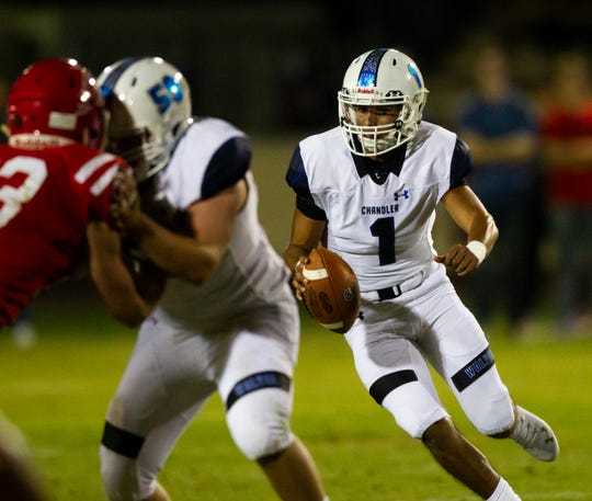 Chandler High quarterback Mikey Keene runs the ball during a high school football game against Brophy College Preparatory at Hogan Field at Phoenix College on Friday, Oct. 11, 2019.