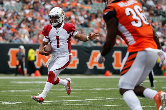 Arizona Cardinals quarterback Kyler Murray (1) runs the ball in the first half of an NFL football game against the Cincinnati Bengals, Sunday, Oct. 6, 2019, in Cincinnati.