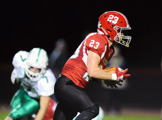 A-C's Evan Heilman (23) heads to the end zone for AC's second touchdown of the game in a game between the Annville-Cleona HS Dutchmen and the Donegal HS Indians played in Annville Friday Oct.11,2019.