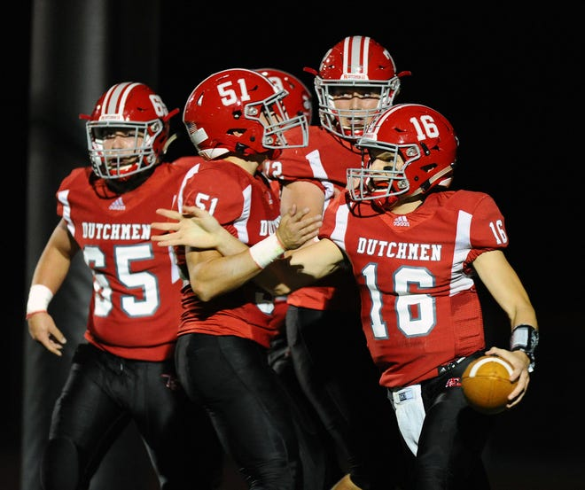 Annville-Cleona's Jeremy Bours Jr.(16) is surrounded by his teammates in the end-zone after he put them up 6-0 in the first quarter of  a game between the Annville-Cleona HS Dutchmen and the Donegal HS Indians played in Annville Friday Oct.11,2019.