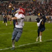 Port Huron's Dawson Leffler catches a long pass in the fourth quarter of the Cross-Town Showdown Friday night.
