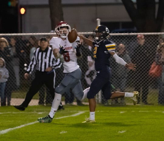 Port Huron's Dawson Leffler makes a catch for a long gain in the first quarter as Port Huron NorthernÕs Pernell Robinson-Meeks covers during the Cross-Town Showdown Friday night at Memorial Stadium.