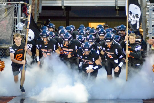 The Marine City football team takes the field before facing rival St. Clair on Friday, Oct. 10, 2019, at East China Stadium.