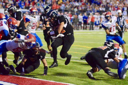 Marine City's Aren Sopfe jumps into the end zone against St. Clair during a Macomb Area Conference-Silver football game on Friday, Oct. 11, 2019.