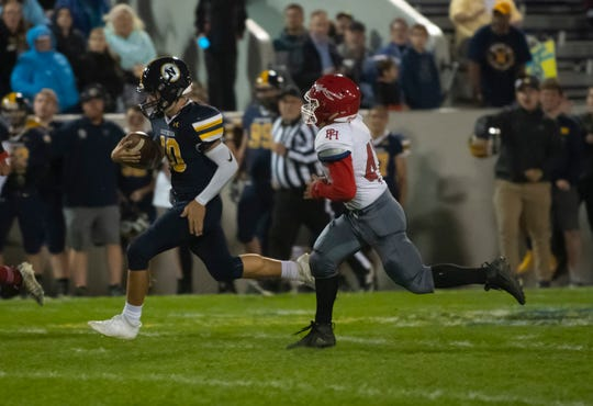 Port Huron Northern's Seth Klink runs the ball for a long gain during the second quarter of the Cross-Town Showdown Friday night at Memorial Stadium.