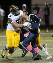 Lourdes' Jake TImm blocks a  Poughkeepsie lineman during Friday's game on October 11, 2019.