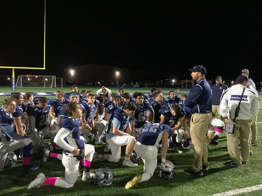 Coach Tom O'Hare talks to his John Jay-East Fishkill High School football players, after their 38-0 win over North Rockland Friday.