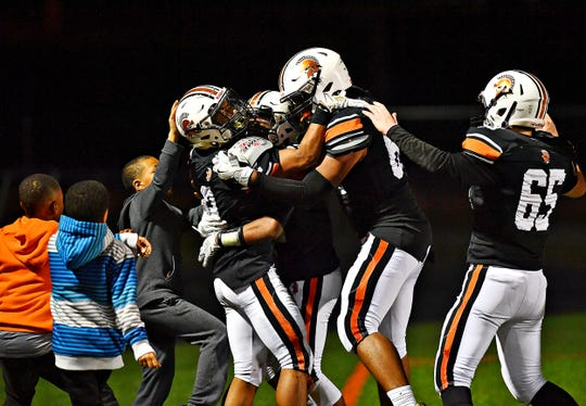 The York Suburban players celebrate during last week's win over Gettysburg. The Trojans are 8-0 on the season.