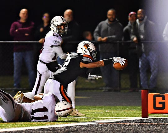 Gettysburg's Gunner Wilson, left, can't stop York Suburban's Savion Harrison from scoring a touchdown during football action at York Suburban Senior High School in Spring Garden Township, Friday, Oct. 11, 2019. York Suburban would win the game 30-19. Dawn J. Sagert photo