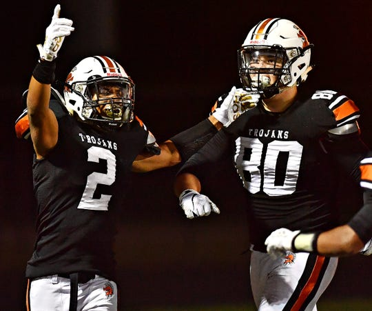 Savion Harrison, left, and Matthew Bentivegna celebrate during York Suburban's football win over Gettysburg on Friday night. Suburban is 8-0.