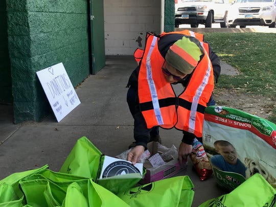 Jessie Ebbe , 36, organizes bags of supplies, which volunteers hand out to the homeless near Pickett Park on Saturday, Oct. 12, 2019.