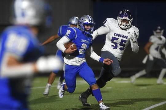 McQueen's Cody Ciglar runs against Spanish Springs during their football game in Reno on Oct. 11, 2019.