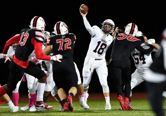 Aquinas' Tyler Szalkowski throws a pass from the pocket against Hilton during a regular season game at Hilton High School, Friday, Oct. 11, 2019.