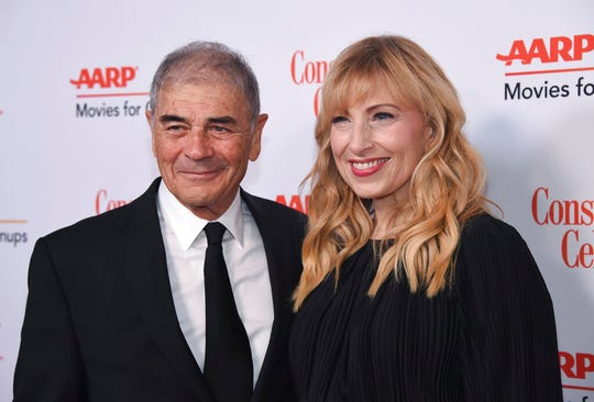 """FILE - In this Jan. 4, 2019 file photo, Robert Forster, left, and Denise Grayson attend the 18th Annual Movies For Grownups Awards at Beverly Wilshire Hotel, in Beverly Hills, Calif. Forster, the handsome character actor who got a career resurgence and Oscar-nomination for playing bail bondsman Max Cherry in """"Jackie Brown,"""" has died at age 78. Forster's agent Julia Buchwald says he died Friday, Oct. 11, 2019, at home in Los Angeles of brain cancer. (Photo by Phil McCarten/Invision/AP, File)"""
