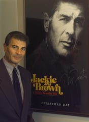 Actor Robert Forster poses with his movie poster at the Little Theatre on Sunday during an early screening in 1997.