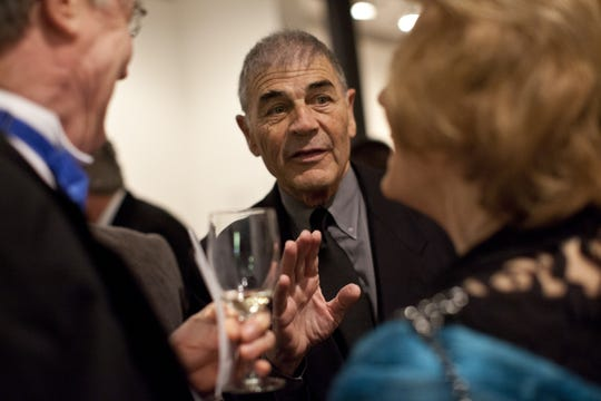 Robert Forster speaks with guests before dinner at the March 2013 opening of the newly renovated Dryden Theatre at the George Eastman House.