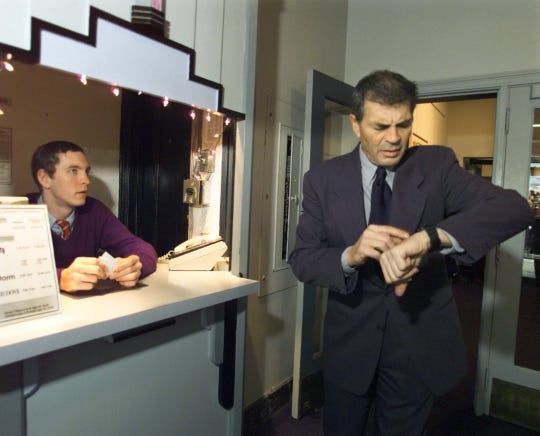 """Actor Robert Forster checks his watch as the Little Theatre's  Justin Eygabroat prepares to start an early screening of Quentin Tarantino's """"Jackie Brown."""" by Quentin Tarantino Sunday afternoon. The film was Forster's biggest hit."""
