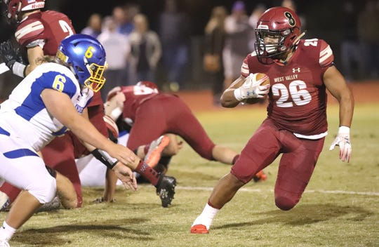 West Valley's Josh Aguilar, right, takes the ball downfield with Anderson's Cody Crawford in pursuit on Friday, Oct. 11, 2019. West Valley won 60-29 on its homecoming.