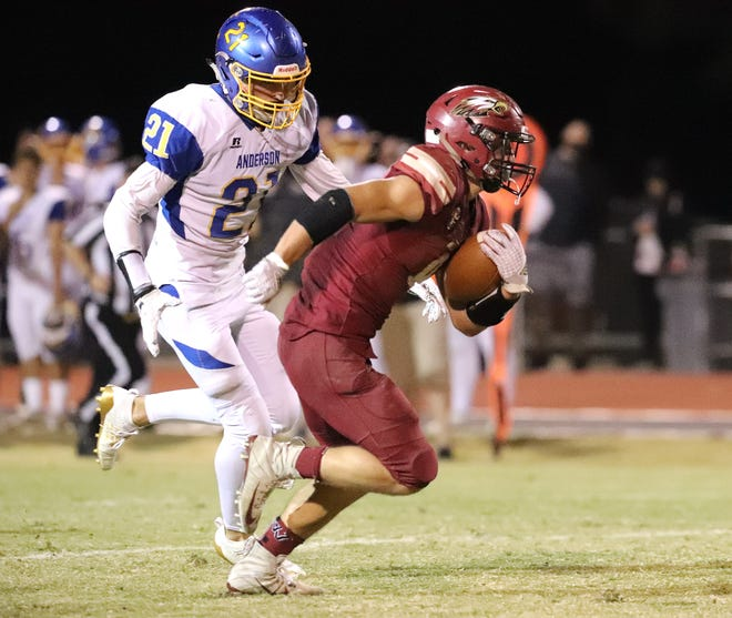 West Valley's Cade Lambert runs for one of his four touchdowns while Anderson's Christian Teague tries to catch him Friday, Oct. 11, 2019. West Valley beat Anderson 60-29.