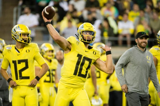 Oct 11, 2019; Eugene, OR, USA; Oregon Ducks quarterback Justin Herbert (10) warms up before a game against the Colorado Buffaloes at Autzen Stadium. Mandatory Credit: Troy Wayrynen-USA TODAY Sports