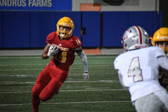 Palma wide receiver Micah Servano Olivas (14) takes a reverse around the corner against Carmel. Oct. 11, 2019.