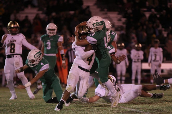 Wall High School's Bryson Ballard (14) tackles Clyde's Donovan Gomez (4) during a District 3-3A Division I football game Friday, Oct. 11, 2019, at Hawk Stadium in Wall.