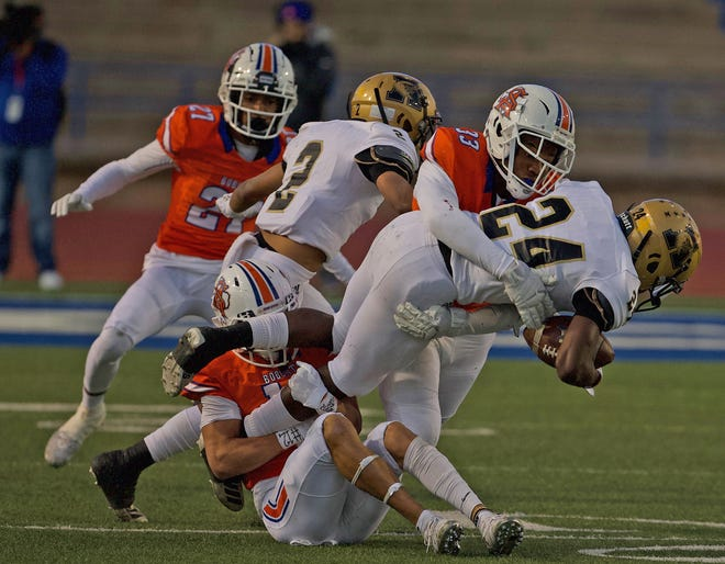 Xy'Kerion Paulk, far right, makes a tackle for Central on Friday, Oct. 11, 2019.