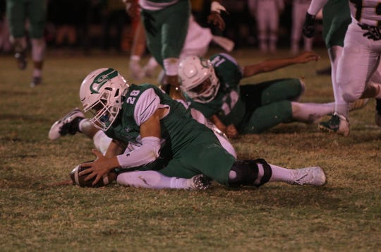 Nate Fedor recovers a fumble for Wall on Friday, Oct. 11, 2019.