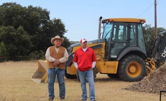 Tom Green County commissioner Bill Ford and John Bendure were part of a groundbreaking ceremony Saturday, Oct. 12, 2019, in Pugh Park in Christoval for a new athletic complex housing baseball, softball and cross country areas for use by Christoval ISD and Christoval Little League.