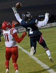 Airline's Brandon Mashall breaks up a pass against Haughton's CJ McWilliams Friday in the District 1-5A contest at Airline's M.D. Ray Field.