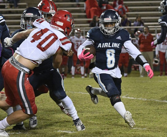 Airline's Jamal Johnson heads around the end as Haughton's Dylan Turner prepares to make the stop.