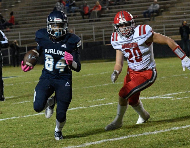 Haughton's Jake St. Andre (20) seeks to track down Airline's Kevin Pouncy in a game last sesaon.