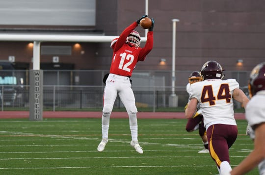 Lincoln receiver Ty Schafer leaps for a catch during the Class 11 AAA matchup against Harrisburg on Friday night at Howard Wood Field in Sioux Falls.