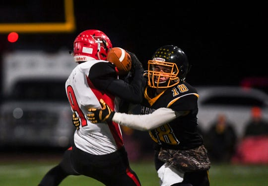 Colman-Egan wide receiver and defensive back Ryan Voelker (18) tackles Dell Rapids St. Mary wide receiver and defensive back Weston Geraets (9) during the game on Friday, Oct. 11, 2019.