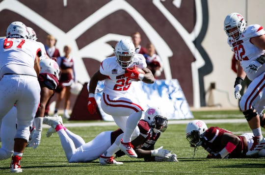 The University of South Dakota's Canaan Brooks avoids a tackle by Missouri State Defenders as the Bears take on the Coyotes at Plaster Field on Saturday, Oct. 12, 2019.