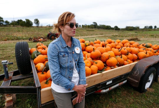 Sarah Larsen talks about Onward Acres, her family farm and pumpkin patch named after a nearby church community that has occupied the land for five generations, near Miller, Mo., on Wednesday, Oct. 9, 2019.