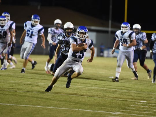 Fort Defiance's Trevor Bartley scores one of his four touchdowns in a win over Staunton.