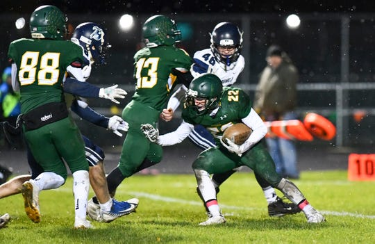 Christian Rodriguez carries the ball for the Storm during the first half of the Friday, Oct. 11, 2019, game against Bemidji in Sauk Rapids.